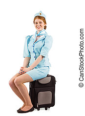 Pretty air hostess smiling at camera on white background