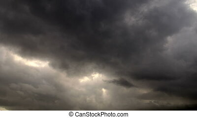 Storm Clouds at Sunset - Dark stormy clouds forming at...