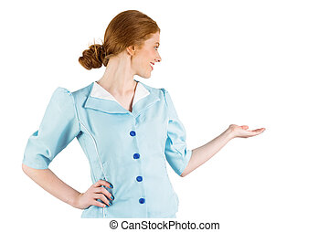 Pretty air hostess presenting with hand on white background