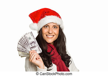Woman holding some money on white background