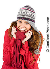 Cold redhead wearing coat and hat on white background
