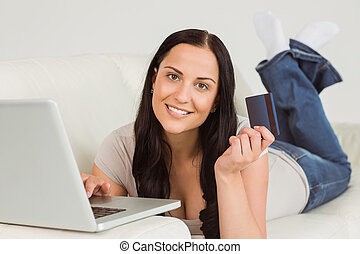 Woman ordering shopping from online on white background