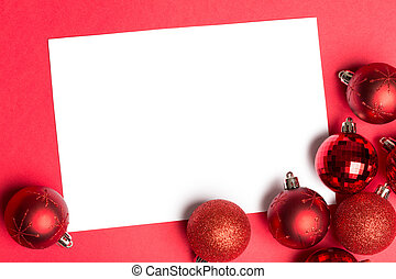 White page with red christmas baubles on red background