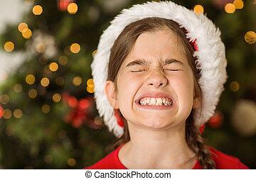Little girl scrunching up her face