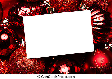 White page on red christmas baubles on red background
