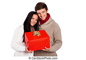 Young couple holding a gift