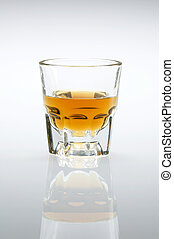 Whiskey shot vertical - Shot glass filled with whiskey or...