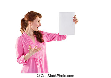Woman shocked looking at paper on white background