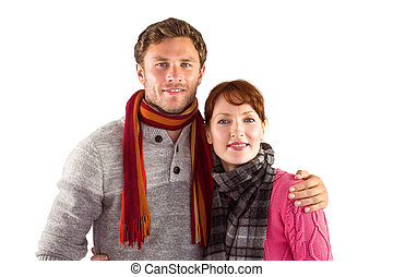 Couple holding each other on white background