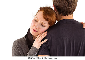 Scared woman holding onto man on white background