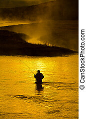 Man Fishing in River Early Morning