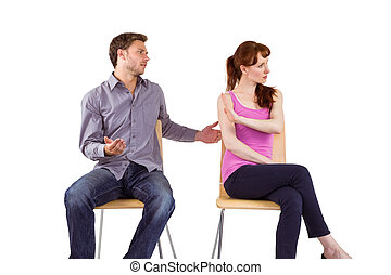 Sitting couple having an argument on white background