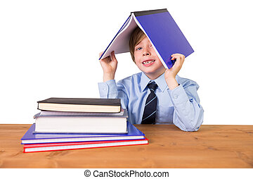 Student covering head with book