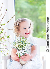 Beautiful toddler girl with flowers - Beautiful curly...