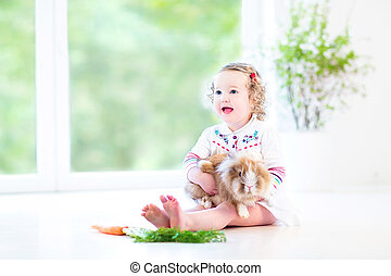 Cute toddler girl with real bunny - Adorable toddler girl...