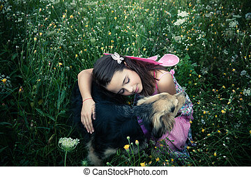 little fairy - girl like a fairy sitting in grass meadow...