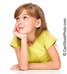 Portrait of a pensive little girl supporting her head with...
