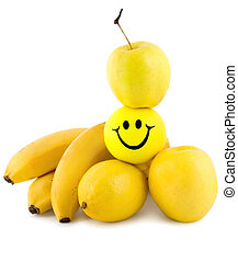 food pyramid banana ,apple,lemon,smiles isolated on white...