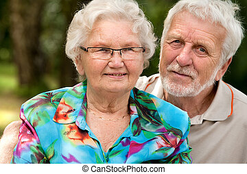 Happy Senior couple portrait - Elderly couple enjoying the...