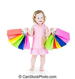 Girl after sale with colorful bags - Adorable little girl...