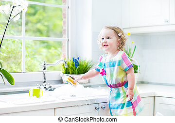 Cute curly toddler girl dress washing dishes - Cute curly...