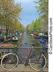 Bike on a bridge in Amsterdam - Bike on a canal bridge,...