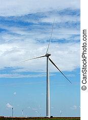 Electric Wind Turbine sunny sky with clouds - A wind turbine...