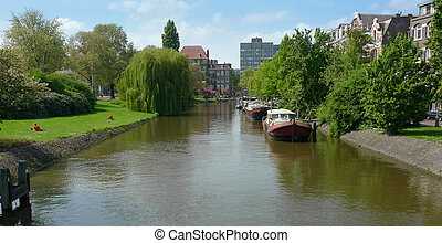Canal and houses - Boat houses along a canal in Plantage...