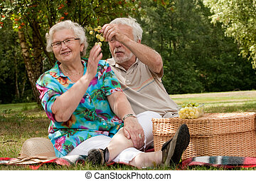Senior couple eating some fruit - Elderly couple enjoying...