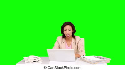 Businesswoman celebrating at her desk on green screen...