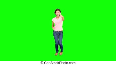 Excited pretty woman smiling and dancing on green screen...