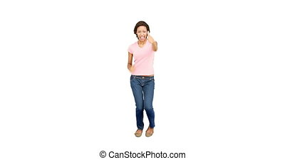 Pretty excited woman dancing and smiling on white background