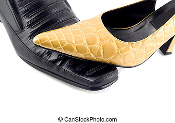 female shoes on male shoes - Female hoes close-up isolated...
