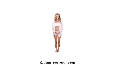 Pretty fit blonde doing yoga on white background
