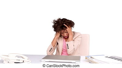 Businesswoman feeling stressed at her desk on white...