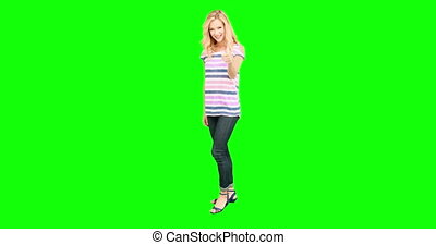 Pretty blonde smiling at camera on green screen background