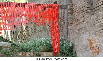 Red plastic fence on reconstruction - Red plastic fence on...