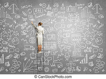 Business planning - Rear view of young businesswoman...