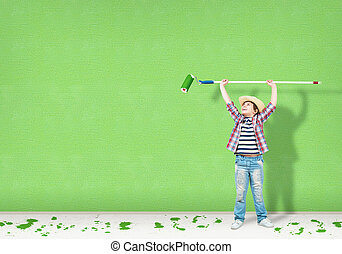 boy in a hat with a roller for painting