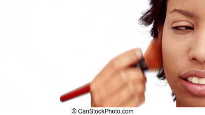 Make up artist putting powder
