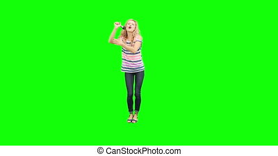 Pretty blonde singing and moving on green screen background