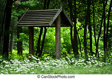 wooden gazebo park - Wooden arbour among shady trees