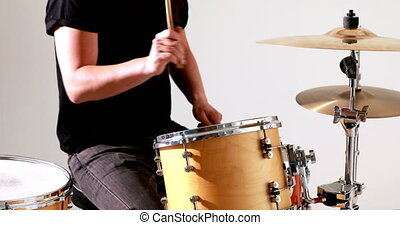 Drummer playing his drum kit in the studio