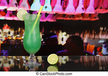 Green fruit juice cocktail in a bar