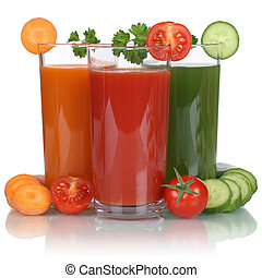 Healthy vegan eating vegetable juice from carrots, tomatoes...