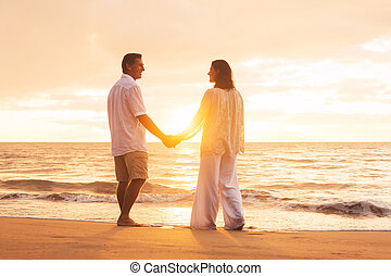 Mature Couple Enjoying Sunset - Romantic Senior Couple...