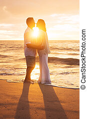 Mature Couple Kissing at Sunset