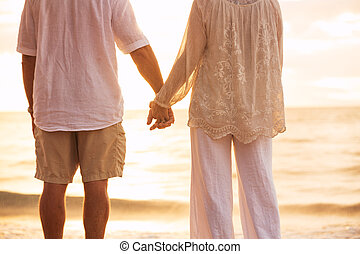 Mature Couple Holding Hands Enjoying at Sunset - Romantic...