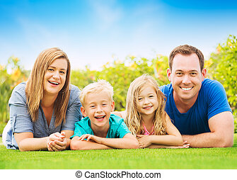 Happy Family - Portrait of Happy Family Outside on Grass