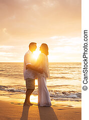 Mature Couple Kissing at Sunset - Romantic Mature Couple...